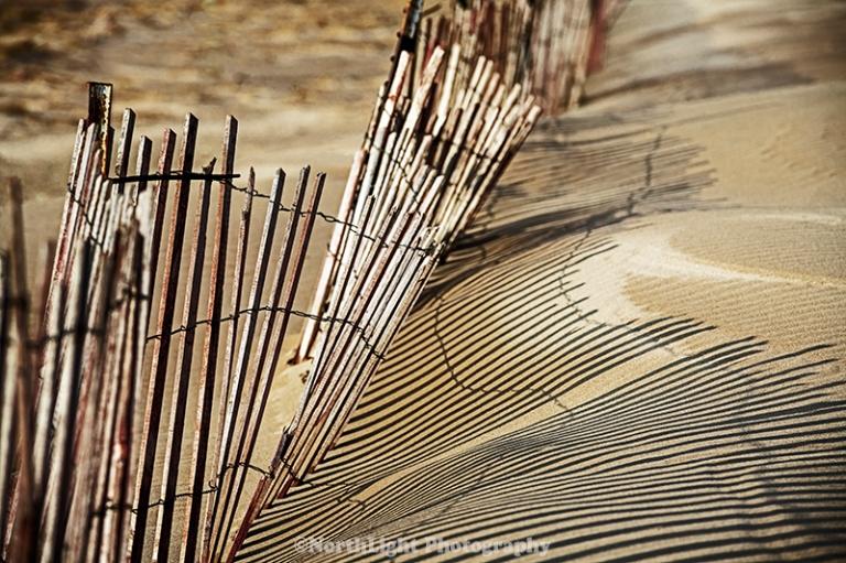 Snow fence all beach near the Ludington State Park Beach House.