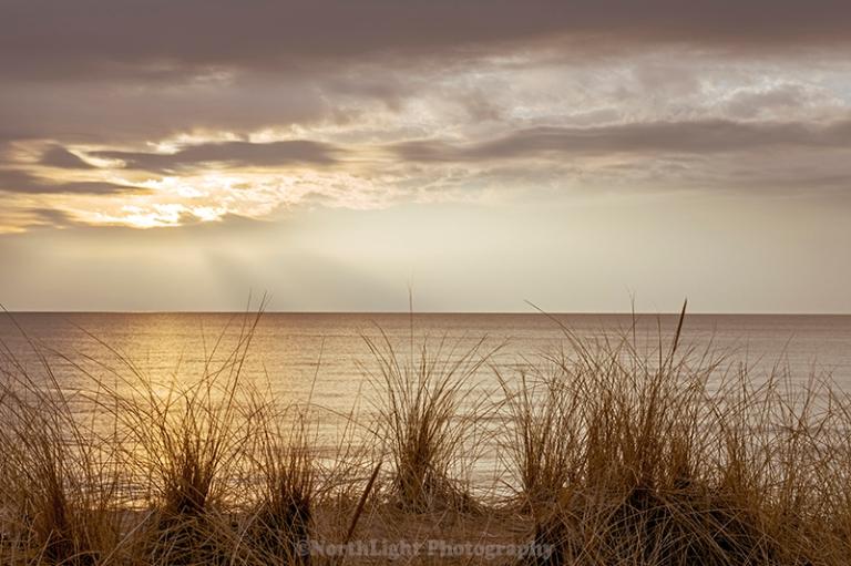 Sunset over Lake Michigan and Ludington State Park near Ludington, Michigan, USA