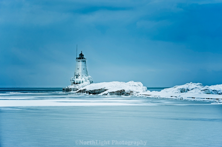 Mid-winter view of the north break wall lighthouse in Ludington, Michigan, USA